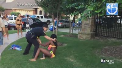 პოლიციელმა 14 წლის გოგონა თმით ითრია